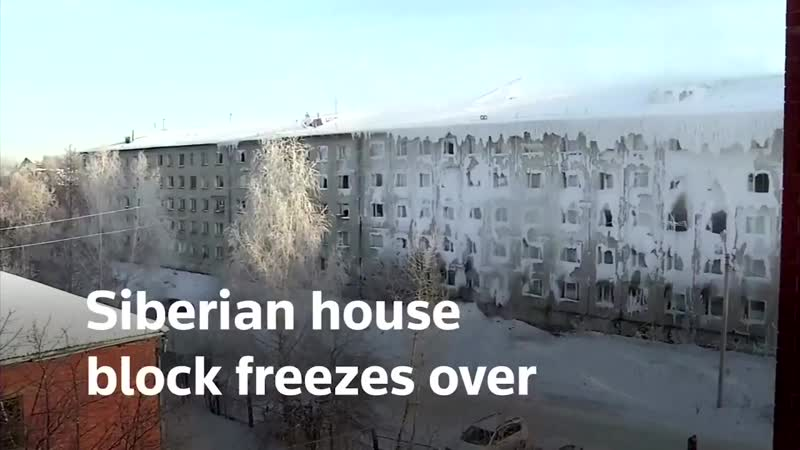 A housing block in the Siberian city of Irkutsk is frozen both inside and outside after water from burst pipes formed ice coveri