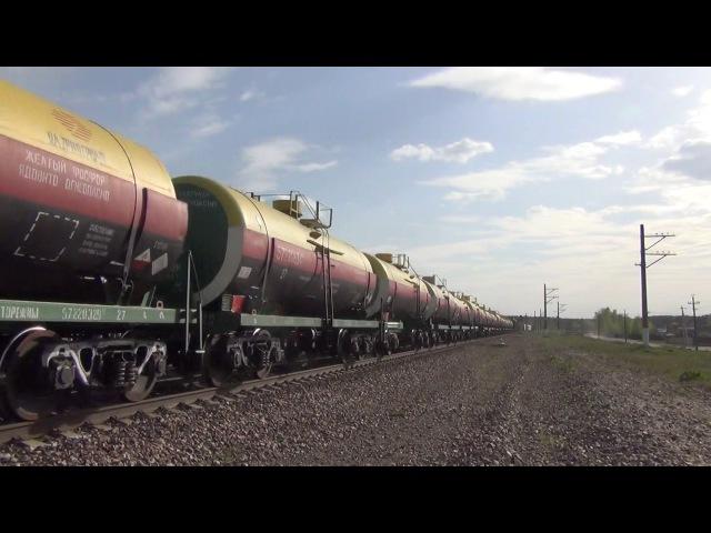 Тепловоз 2ТЭ25МК 0182 с грузовым поездом