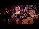 Bailan una milonga Beba BIdart y Tito Lusiardo. Troilo y Grela tocan Milonga La Trampera.