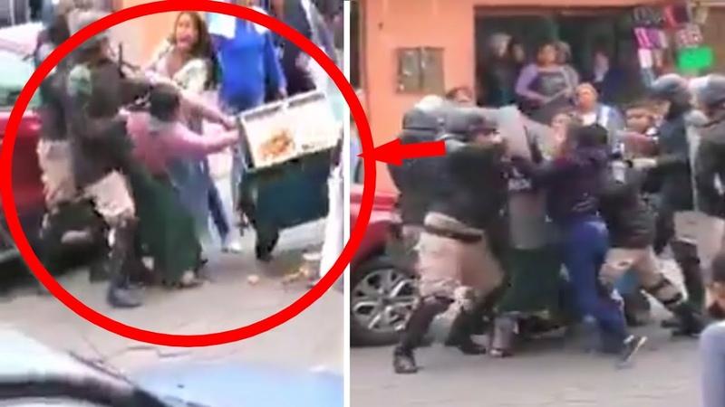 BOLIVIA POLICÍAS GOLPEAN y Destruyen Pequeño negocio de Mujer de Pollera en Santa Cruz