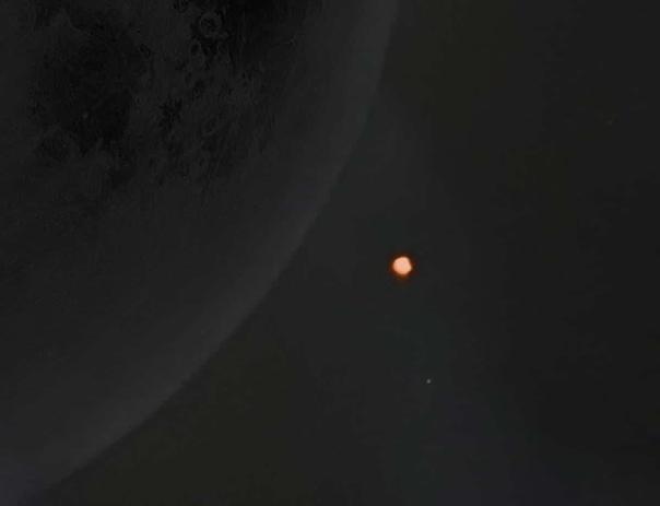 Фотограф сделал потрясающий снимок Марса, выглядывающего из-за Луны